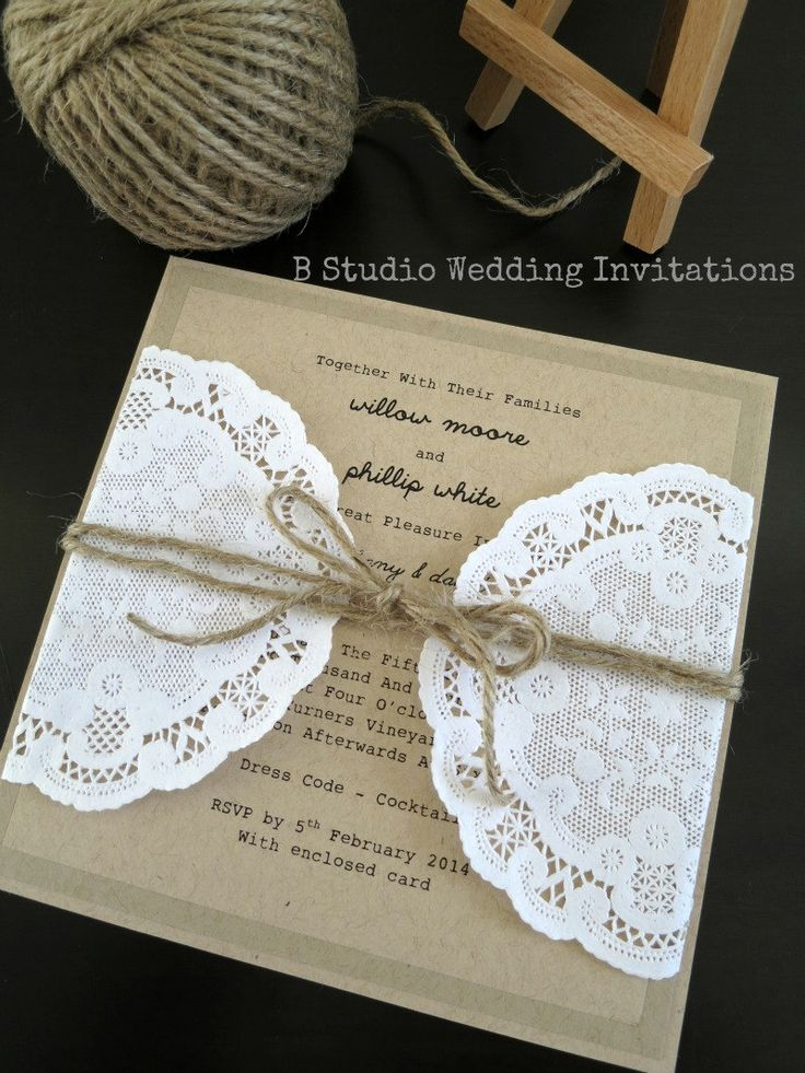 Rustic wedding invitation with twine and doily