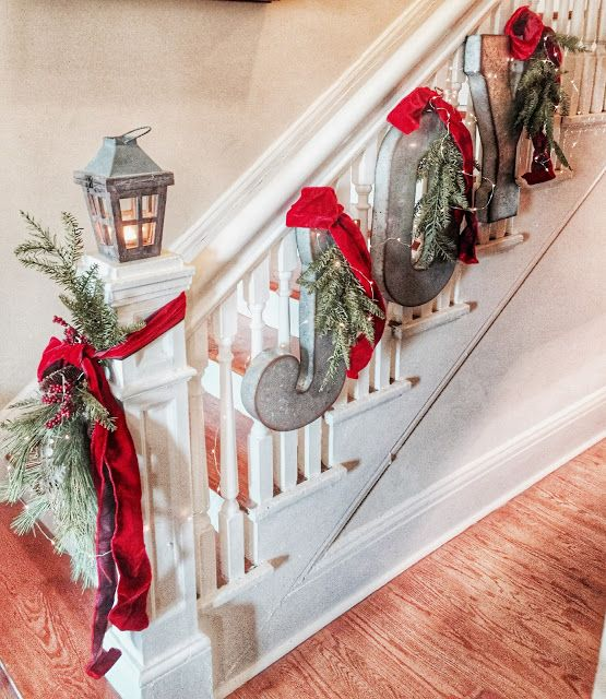 Love these hanging galvanized letters on the stairs! What a creative and expensive way to decorate your stairway for the holidays.