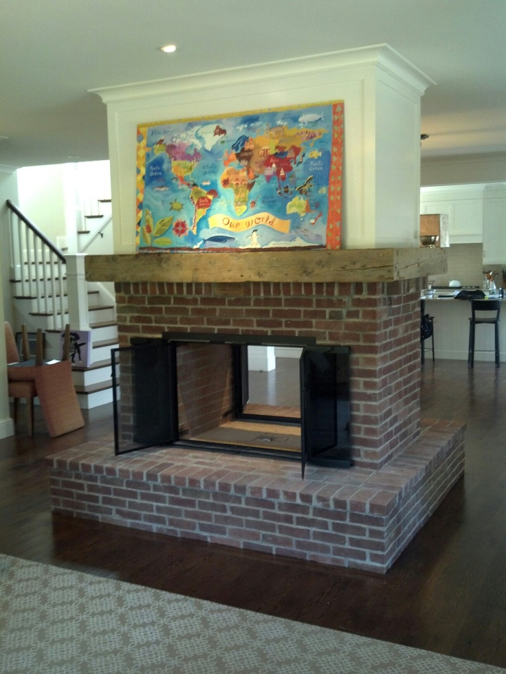 Cape cod cornerstone inc old world brick fireplace for Through fireplace