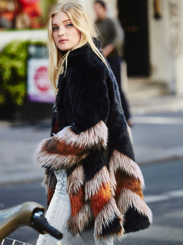 Elsa Hosk - Free People Chevron Fur Coat at Free People Clothing Boutique - Inspired by decades past, this statement faux fur coat features a contrast chevron design. Hidden hook-and-eye closure and hip pockets.