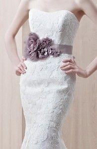Purple flower dress belt decoration on white lace wedding dress