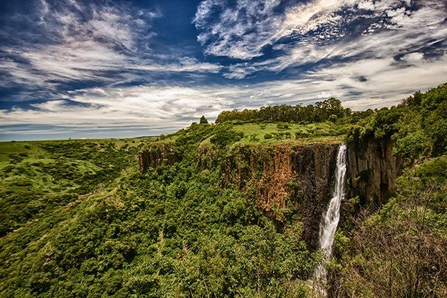 """Howick Falls - Located 24km from Pietermaritzburg en route to Durban. The name means """"The Place of the Tall One"""" in Zulu because of the great height (95m) from which the water travels to reach the Umgeni River below. The scenic beauty from the top of the Falls is mesmerising, and there are numerous walking trails to enjoy. A walk from the top to the bottom of the Falls takes about an hour."""