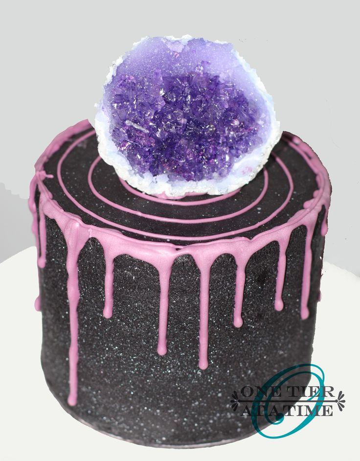 Amethyst geode drip cake - black ganache with purple chocolate drip.  Rock candy and sugar crystal geode