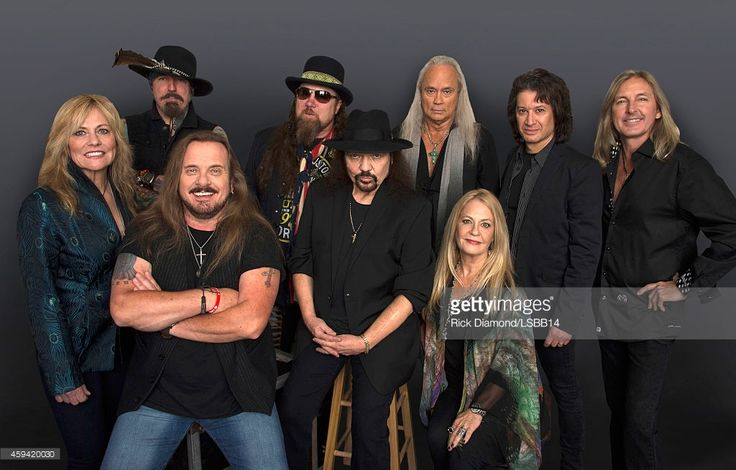 This image has been retouched.) Carol Chase, Johnny Colt, Johnny Van Zant, Peter Keys, Gary Rossington, Rickey Medlocke, Dale Rossington, Michael Cartellone, and Mark 'Sparky' Matejka of Lynyrd Skynyrd pose backstage at One More For The Fans! - Celebrating the Songs