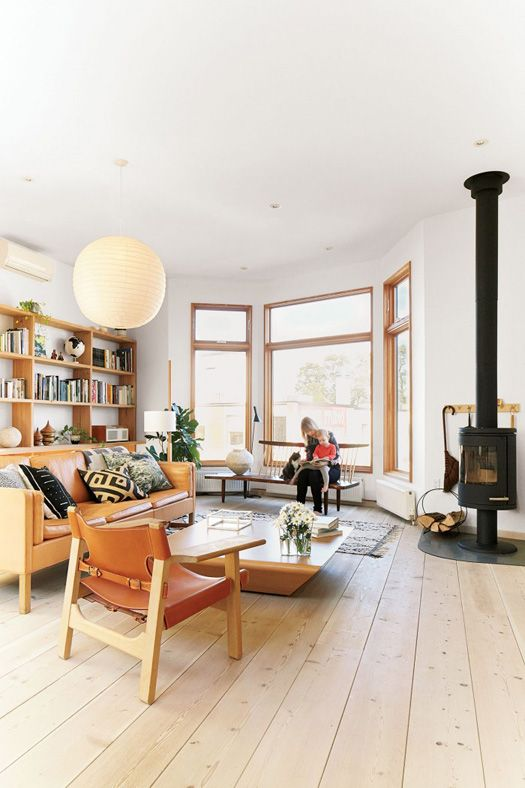 Living Room with leather chairs and wood burning stove #neutral decor