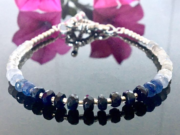 A personal favourite from my Etsy shop https://www.etsy.com/no-en/listing/539507127/sapphire-bracelet-blue-and-white-ombre