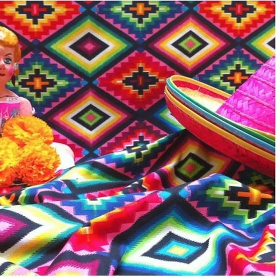 "Mexican symbol  ""Ojo de Dios,"" or ""God's Eye""  ""eye-dazzler,"" in   Paranda Pink - FOLKLORICO collection by Alexander Henry."