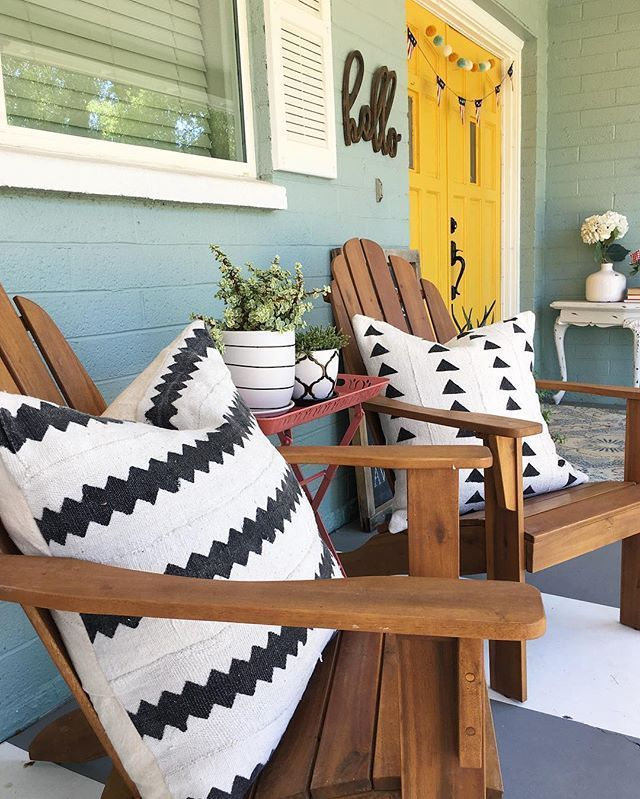 Pretty summer front porch decor! Love this striped porch too! Fun yellow front door and cute aqua house!