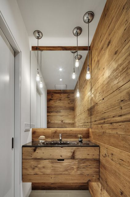 Contemporary Powder Room by Blender Architecture4. Rustic wood. Similar to the textures found naturally in stone, the grain, knots and grooves of wood are exciting design elements. While you may think this material is too rustic for your taste, check out this fabulously chic and modern washroom clad in wood.