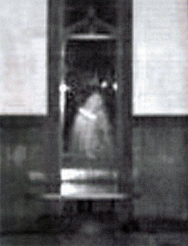Several unnerving instances of ghost and poltergeist activity were reported by the management, staff, & customers of the Godfather's Pizza restaurant in Ogden, Utah in 1999-2000. An investigation found that the restaurant might have been built upon a very old pauper's field - a cemetery for the poor. This photo, was taken by Merry Barrentine, UPER's general manager, in 2000. The misty apparition was actually seen with the naked eye for a few seconds as it materialized in the middle of the…