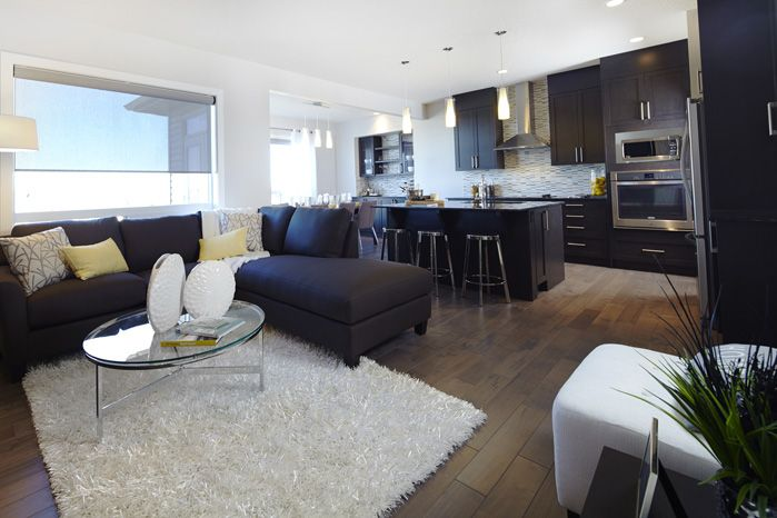 Open main floor layout in the Tofino II showhome in Hillcrest in Airdrie by Shane Homes.