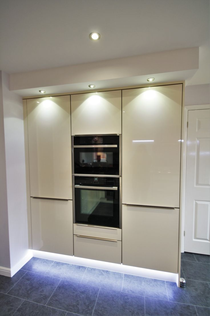 Tower unit with two stacked Neff appliances, storage to the left and an integrated fridge/freezer to the right.