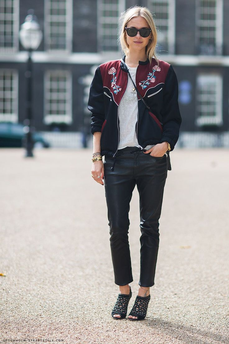 An embroidered bomber jacket is an absolute classic. I love this cowgirl-inspired one as seen at London Fashion Week! It looks great with a simple white tee and black leather trousers for a great daytime look