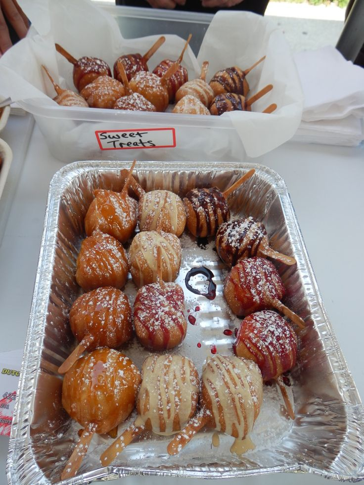 """CNE 2013 From Sweet Treats: Doughnut batter filled with Rice Krispies and marshmallow, drizzled in either raspberry, vanilla, caramel or chocolate. Sweet Treats is also home to the famed deep-fried butter, and the """"breakfast of champions"""": deep-fried butter and chocolate-covered bacon."""