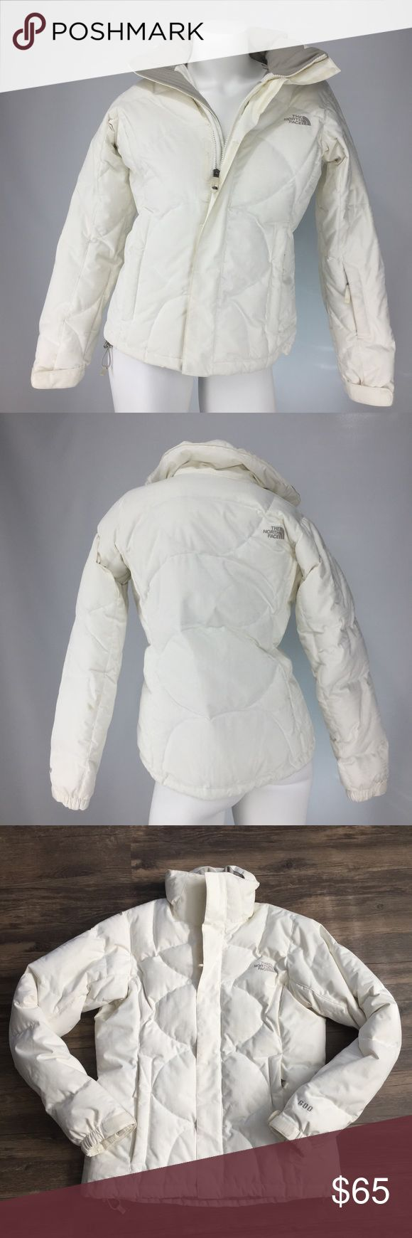 THE NORTH FACE 600 Series Goose Down Coat! THE NORTH FACE 600 Series Goose Down Coat! Beautiful white goose down coat featuring zip and velcro closure, exterior zip pockets on front and sleeve,  interior zip cell phone pocket, and drawstring waist band. THE NORTH FACE logo on front and back. Gorgeous coat in great condition! The North Face Jackets & Coats Puffers