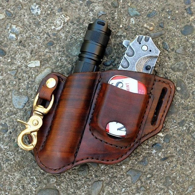 Custom leather belt holster for a folding knife, flashlight and altoids tin.