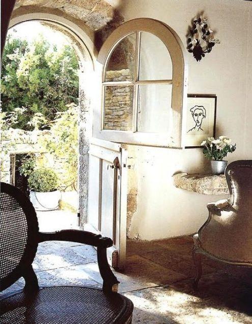 Love the arched dutch-door..