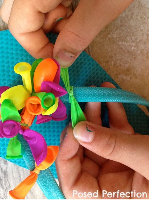 Flip flops decorated with water balloons.