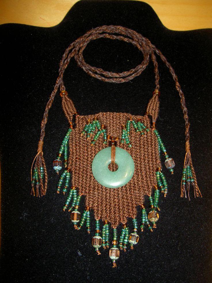 """Jade Donut"" - 2013 - Adjustable length, Jade donut centerpiece, SOLD.  Woven by Terri Scache Harris, theravenscache.shutterfly.com   Hand woven, handwoven, weaving, weave, needleweaving, pin weaving, woven necklace, fashion necklace, wearable art,fiber art."