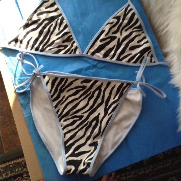 Zebra Bikini Zebra bikini by Bachata by ODABASH IS A SUPER CUTE BIKINI. Zebra print trimmed in light blue make this a daring one to wear. You will get noticed wearing this dynamic jewel.  this bikini ties on. Odabash Swim Bikinis