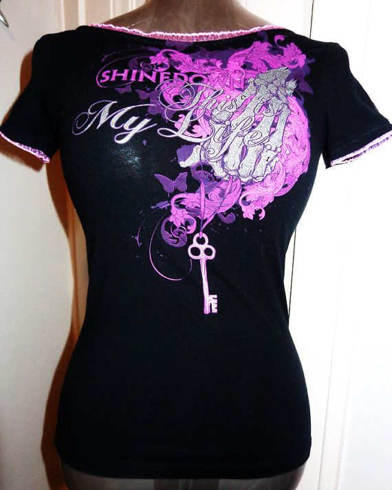 Ladies Shinedown rock band shirt size small. Handcrafted into a feminine ladies fit, with beautiful light pink and lavender ruffled elastic lace on sleeves and neckline. Completely unique, only one available. Won't be made again so get your hands on this while it lasts! Come check out lots of other DIY clothing and shirts from Chop Shop Clothing!  www.facebook.com/chopshopclothing www.etsy.com/shop/chopshopclothing