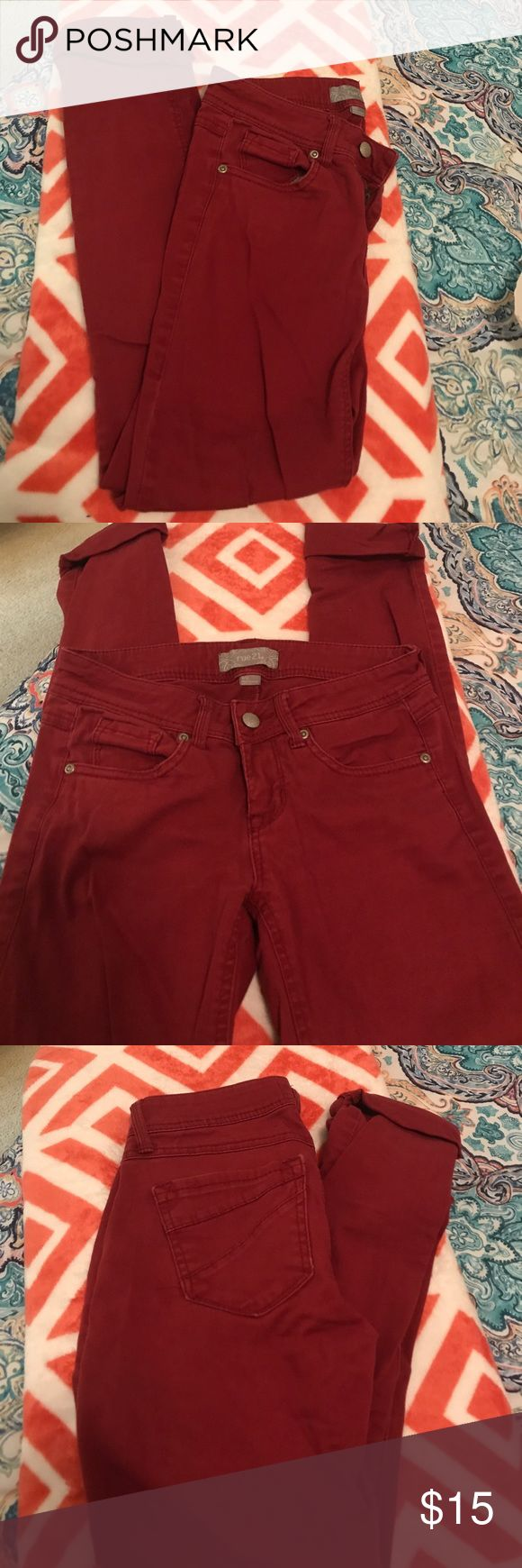 Rue21 Burgundy Skinny Jeans Beautifully colored skinny jeans that are super comfortable! Selling because they're too small on me. Can be cuffed or uncuffed. Has standard 5 pockets. Has a great fit, not super stiff. 98% cotton, 2% spandex. Size 1/2 Rue21 Jeans Skinny