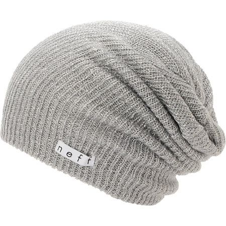 Warm up your wardrobe with a new Neff Girls Daily Sparkle grey beanie that works with any outfit. Instantly warm your head in soft comfort thanks to the ribbed knit construction in the grey colorway, slouchy fit, and a Neff logo tag embroidered near the hem for added style.