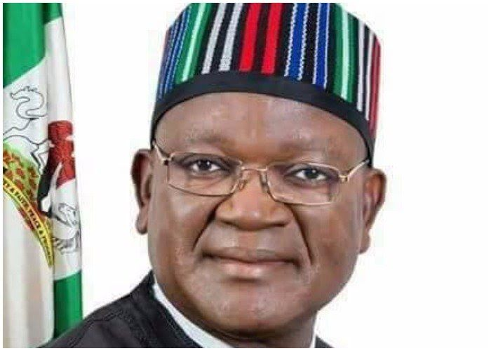 The Priest of St. Christophers Catholic Church Wannune in Tarka Local Government Area of Benue state David Mzer on Wednesday reportedly embarrassed the state governor Samuel Ortom over unpaid workers salaries.  The incident took place during the thanksgiving mass of ex-governor George Akume who celebrated his 64th birthday.  Sun Newspaper reports that an eyewitness who spoke under anonymity said Fr. Mzer a young priest while delivering his sermon at the mass had urged Akume to give quality…