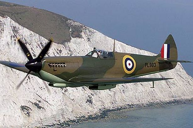 "a beautiful raf spitfire in flight,looks like english ""white cliffs of dover""..."