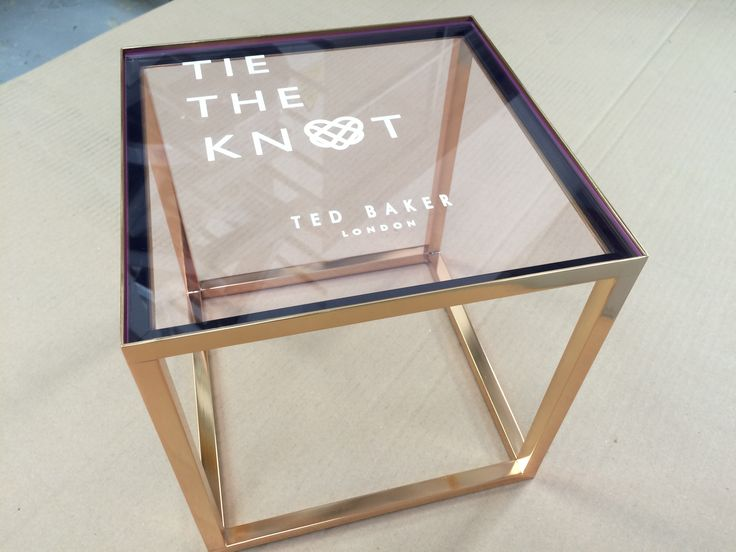 Ted Baker Tie The Knot Footwear Display. Welded steel stand, plated in gold finish with engraved and infilled Fluorescent pink edge clear acrylic.