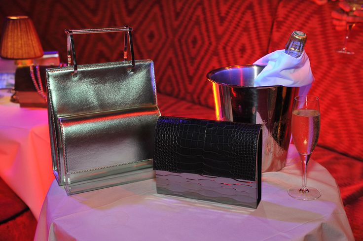 Hugo Matha presented his new styles of Plexi and petrified wood-based clutches in a cabaret atmosphere, aiming to boost France and Paris. Especially key this year: the larger Aymeline leather and Plexi-clutch day bags. — Roxanne Robinson