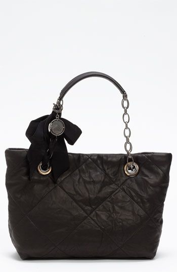 If you don't already own a Lanvin bag...you are missing out! Lanvin is the epitome of beauty, feminity and ease. I love the quilting, the chain handle, the soft smooth leather and the ribbon detail. Yummmmmmy!!!!!