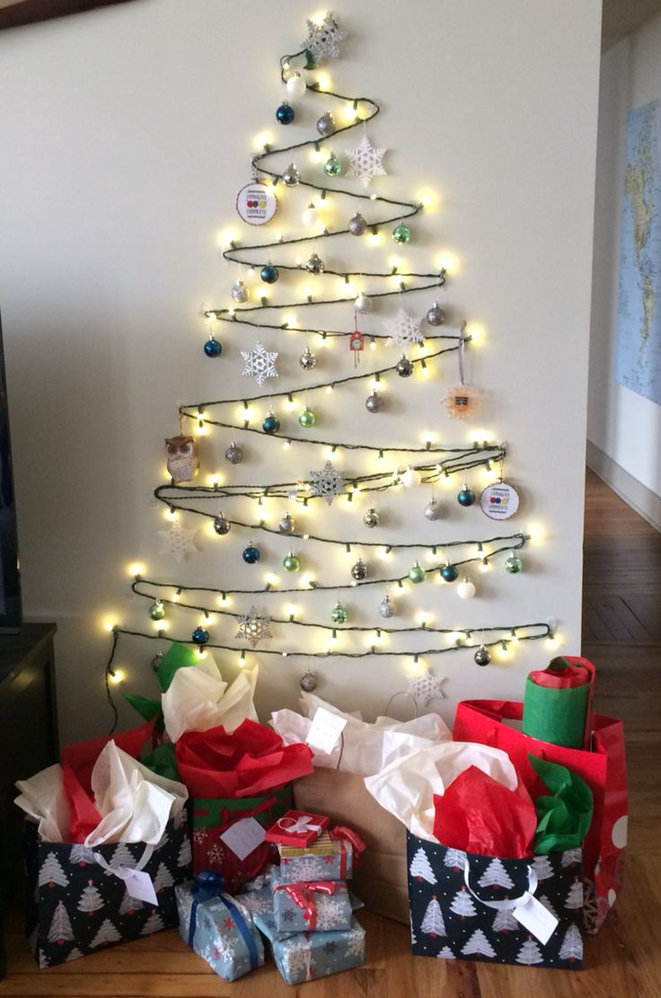 Wall Hooks For Christmas Lights : Wall Christmas tree using lights and Command hooks. Perfect for a small house or apartment ...