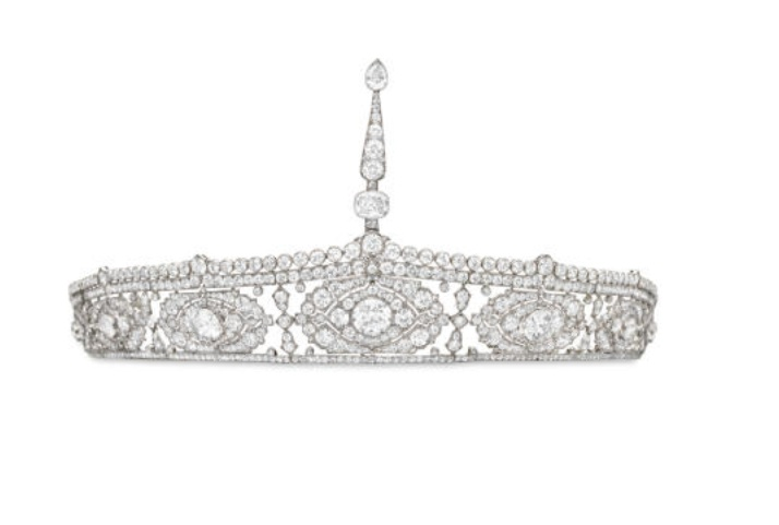 BELLE EPOQUE DIAMOND AIGRETTE BANDEAU, BY CARTIER  Designed as a circular-cut diamond openwork tapered band with tulip-shaped spacers, collet-set detail and scrolled terminals, to the line of seven graduated diamond-set cartouches, each with a central old European-cut diamond and shield-shaped dividers, surmounted by a lancet aigrette fastener, circa 1900, 6½ ins. diameter, with French assay mark, with a Cartier original fitted case