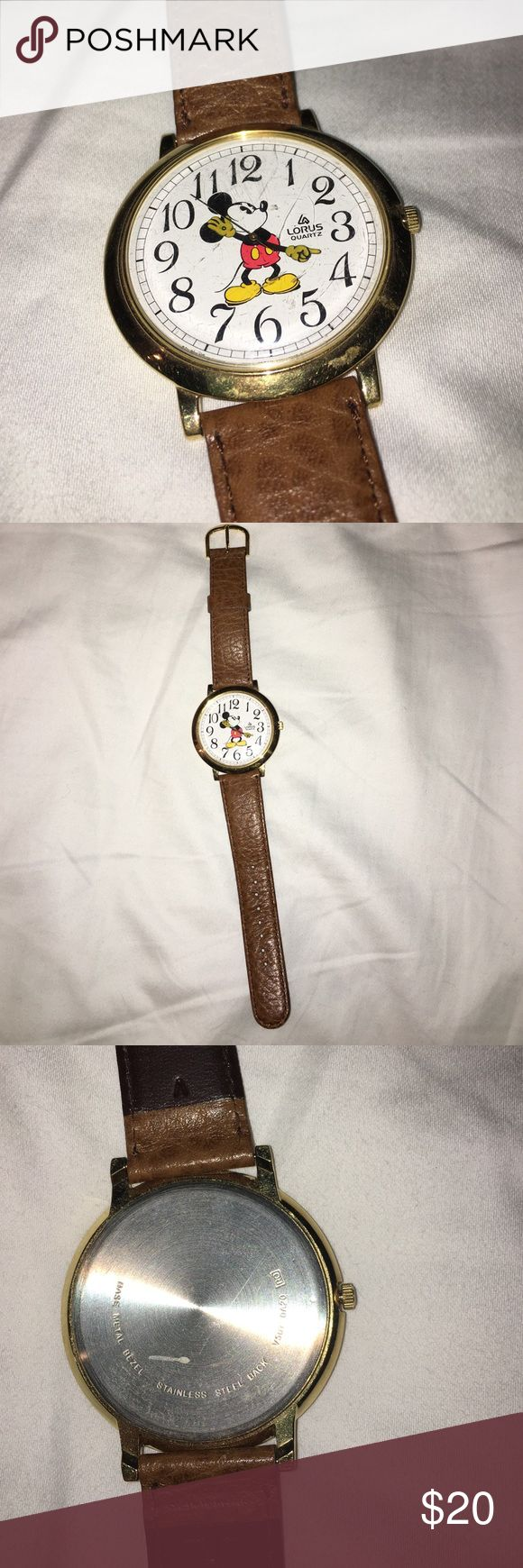 Mickey Mouse Lorus Quartz watch Brown leather band. Stainless steal back. Base is metal bezel. A few scratches on the face and needs a new battery! lorus quartz Jewelry Bracelets