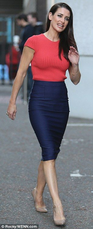 Flaunting her figure: Stepping out in a form-fitting ensemble, the 40-year-old sports presenter made sure that she flaunted her incredible figure to the MAX in a navy pencil skirt and pink knitted top