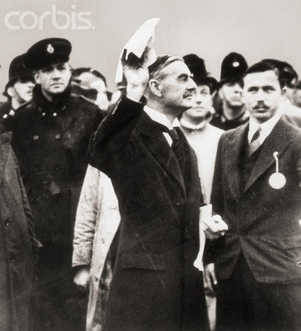 """Prime Minister Neville Chamberlain arrives in London holding the Munich Agreement signed by Germany, France, Great Britain, and Italy in Munich. If all would have held true """"Peace in our time!"""" would have been one of the greatest quotes ever uttered."""