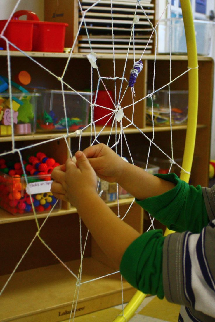 "Make a spider web inside a hula hoop & hang from the ceiling. The children 'catch' bugs by wrapping small plastic minibeasts into the web ("",)"