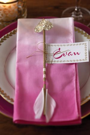 A Valentine's Dinner | Dip-dyed ombre napkins, cupid's arrow, and place cards at each setting