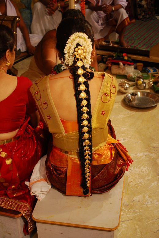 In India, women who wore their long hair tied back in a single braid had gorgeous tasseled ornaments