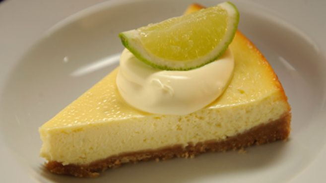 Lime cheesecake topped with a dollop of fresh cream
