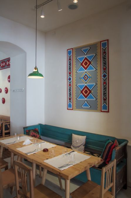 Lacrimi si Sfinti (Tears and Saints) is a restaurant serving modern romanian cuisine. It had to be traditional and contemporary with a bit of wit. It has all the stereotypes of the romanian traditional restaurants including folkloric artifacts, except they are built in LEGO pieces, from carpets hanging on the wall to the trophy animal heads. Most of the furniture is old authentic romanian gathered in various regions of Romania, from Oltenia to Transylvania.