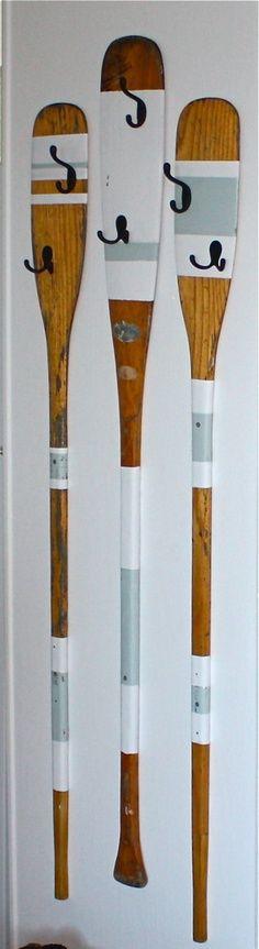 Repurposed oars make a cute beach towel drying area.