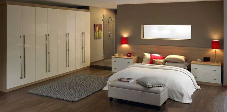 Large Modern Bedroom Cupboards with rectangle grey leather bench on solid hardwood floors as well as two tone nightstand under cool red drum shade bed