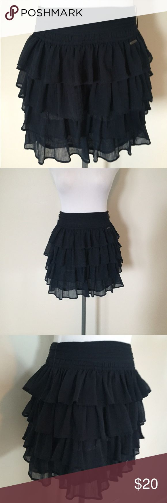 Navy blue ruffle skirt Such a lightweight fun ruffled navy blue skirt and a gorgeous wrap it around my waist height in the back or the front Abercrombie & Fitch Skirts Mini