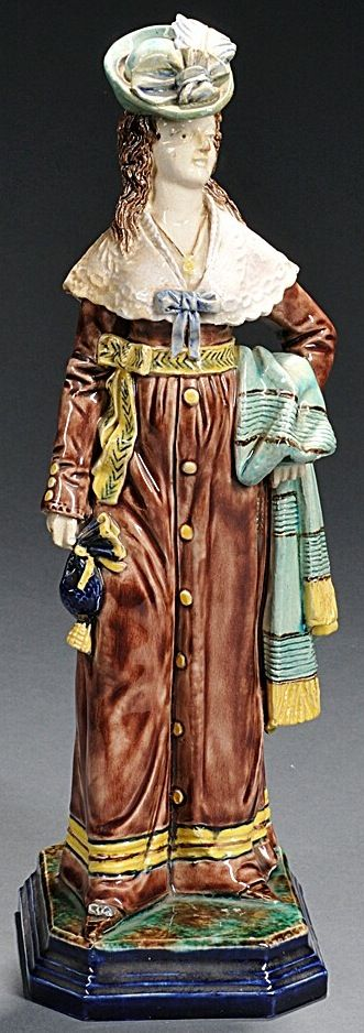 Hugo Lonitz Majolica Figure of a Lady, Germany, c. 1865, the standing figure modeled holding a shawl on one arm, a stringed purse in her other hand, impressed mark, ht. 12 3/4 in.