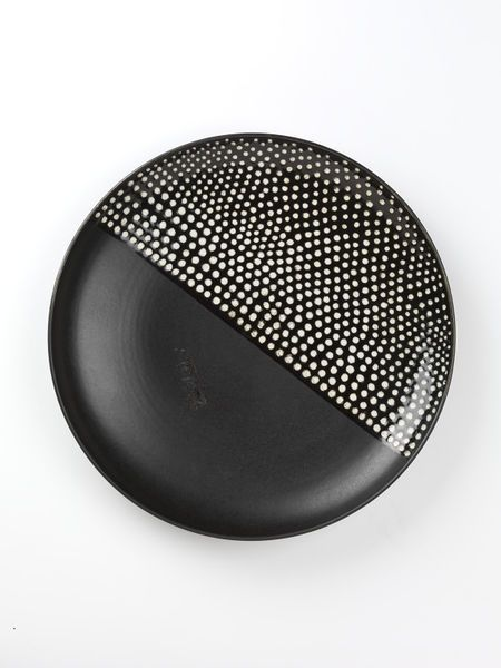 Stoneware dish with printed and incised decoration in semi-matt and glossy black glazes, made by Toini Muona at Arabia, Helsinki, ca. 1968-1970.