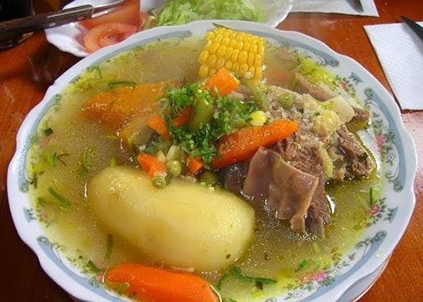 CAZUELA - BEEF SOUP  4 short beef ribs  4 med. potatoes (peeled)  1 thinly sliced carrot  4 pieces corn, cut into 1 1/2 inch lengths  1 tbs...