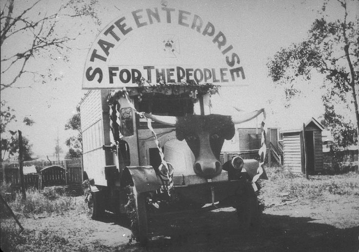 'State enterprise for the people'. Meat truck belonging to State Meat Supply Company decorated for Labour Day procession. Chermside QLD, undated. At Work and Play collection, State Library of New South Wales: http://www.acmssearch.sl.nsw.gov.au/search/itemDetailPaged.cgi?itemID=394945. Digital order no.: bcp_06994.