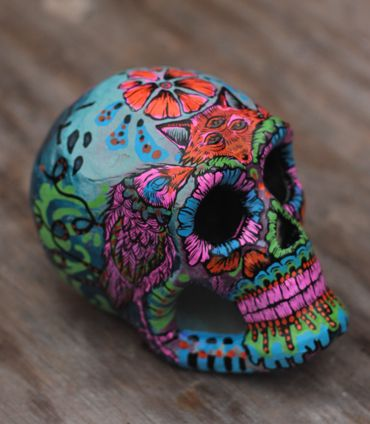 A unique laughing soul. Hand painted, one of a kind paper mache Dia de los Muertos style skull. Signed and dated by artist. Measures roughly 4 inches high, 5 inches deep.    Following proper tradition, this skull can be personalized. Email dedication detail requests.